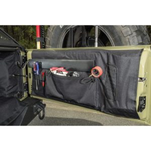 The C3 Interior tailgate Protection guards the entire tailgate surface from damage while adding valuable storage space. The C4 Canine Cube gives four-legged Jeepers a secure and stable area all their own. Photo Credit: Rugged Ridge