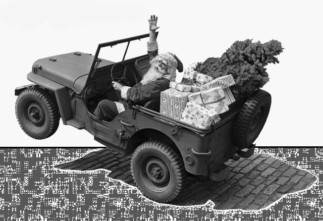 ca. 1942 --- Picture shows Santa Claus in a jeep with a Christmas tree and presents. Undated photo circa 1942. --- Image by © Bettmann/CORBIS